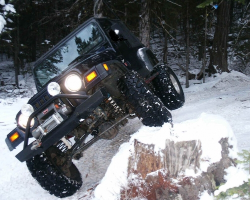 Black-Jeep-Wrangler-Jumping.jpg